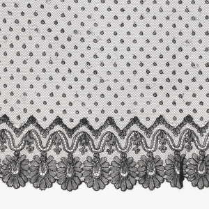 Veil of embroidered black net with a border of black Chantilly-type lace in a floral pattern on three sides and beading for ribbon on the fourth side.