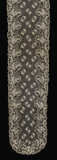 Cap streamer of Alençon lace with a Brussels ground.