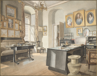 The angled view of this study is dominated by portraits: large oval portraits dating from the Empire period and smaller pictures from the 1820s-1830s. Racks of pipes near the door in the rear and a large businessman's desk in the center foreground show that the room belongs to a man. A large woven urn-shaped basket in the  foreground next to the desk may have served as a wastepaper basket. On the left, a library table sits in front of a banquette. The bare floor of wood planks is in keeping with the Biedermeier style.