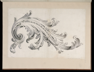 Large, swirling acanthus leaf design consisting of raffle leaves and a repetitive design of small ovals at the center of the arrangement.