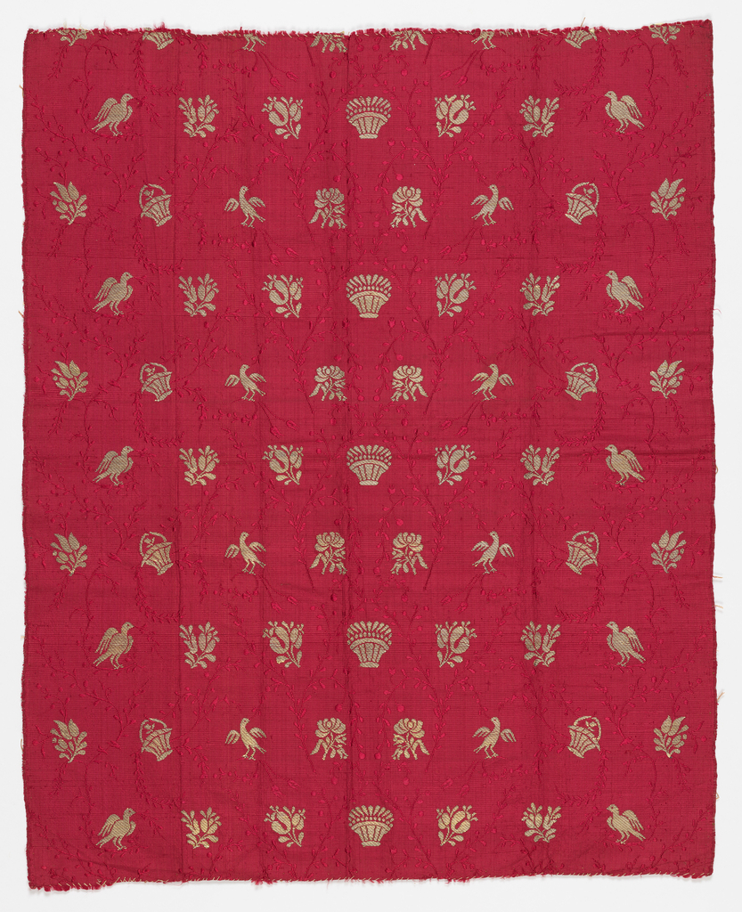 Detatched motifs on ribbed red silk ground.