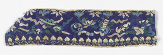 Fragment of narrow trimming of purple satin embroidered with small flowers and Buddhist symbols  in white, blue, and green silks. Backed with pink silk plain weave.