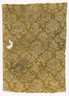 Pattern of upright blossoms and curling floral sprigs in cream on a dark yellow ground.