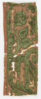 Fragments of a border showing scrolls and plants in green on gold.