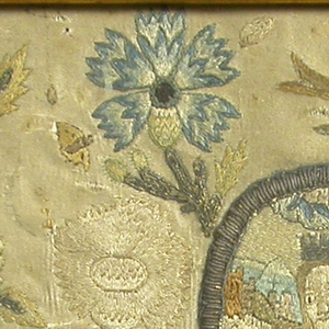 Portrait of the queen, set in an oval framing device, surrounded by flowers, insects, etc., embroidered in colored silks and silver purl.