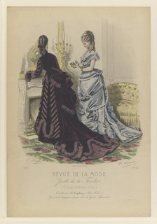 Fashion plate of two woman standing by a fireplace.  Woman with back turned shows the back of her deep purpple velvet long sleeved jacket and skirt.  A large bustle with draping fabric and train of dress.  There are panels of stripped fabirc on front of dress and along the sleeves of jacket.  Gathered fabric in a lighter shade of purple create trim along the bottom of skirt, bustle, and end of flared sleeves.