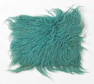Shag rug sample known as flokati in blue-green.