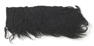 Shag rug sample known as flokati in black.