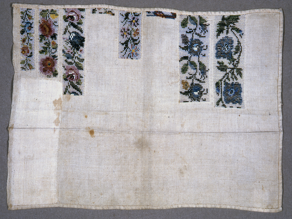 Six narrow bands of florals. Two bands unfinished. Approximately half of sampler is covered by beadwork.