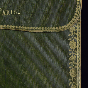 Salesman's sample book of 285 small samples of wool and cotton, mounted on paper and bound in gold-tooled green leather book. Many samples have the appearance of duvetyn, a soft woolen fabric with a downy nap that was used for waistcoats.