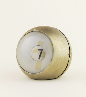 Prototype for table clock in the shape of a ball with a window that displays the numbers.