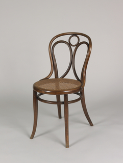 Curvilinear, laminated bentwood frame, the back elements shaped into one circular and two elliptical loops; circular caned seat; circular stretcher below seat; the four legs curving out at feet.