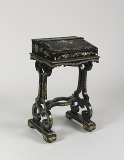 Stand (a), the top inlaid with mother-of-pearl and black checkboard, decorated with gold 'S' curve supports with stretcher on bases with wheels, inlaid with mother-of-pearl and decorated with gold.  Portable writing desk (b), with mother-of-pearl inlay, decorated with gold and painted with spray of flowers, the slant top opening to reveal a writing surface covered in embossed dark blue velvet, supported by 2 pull-outs with ivory handles. The top back, hinged, opening to pen tray, pigeon holes, etc. Back of top decorated with gold and painted with pink rose and other flowers.