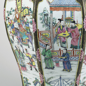 A jar and lid decorated with a fight scene in enamel. The lid has matching decoration with a dragon handle.