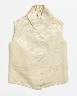 Boy's waistcoat with shawl collar, pocket welts and covered buttons. In off-white silk with a patterned weave alternating satin and ribbed textures in a checkerboard fashion.