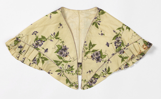 Fichu with piping and ruffled edge, in ivory silk printed with loosely drawn flowering vine in purples and greens.
