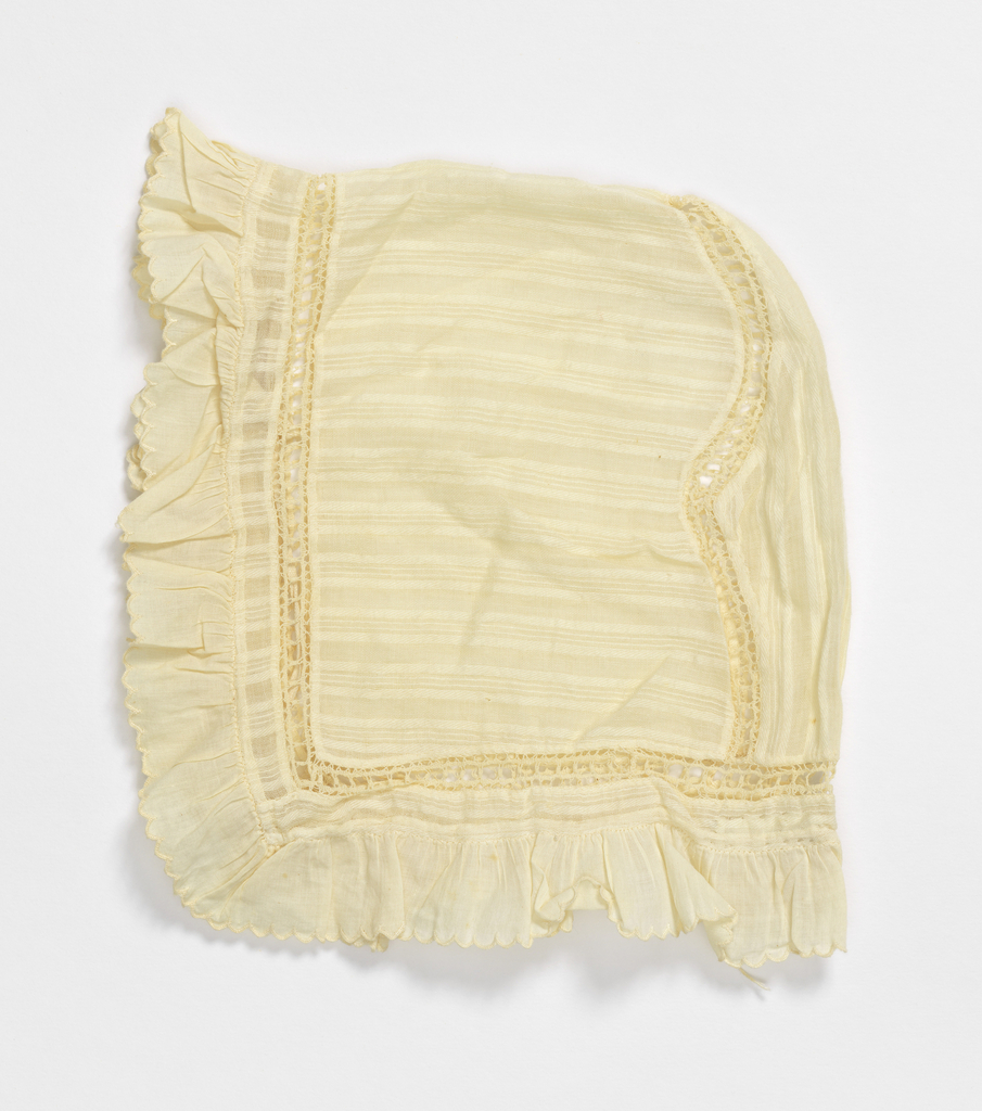 Baby bonnet in white cotton batiste with a white woven stripe. Open work insertion, ruffled edge.