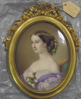 Portrait of the Empress Eugenie, heard and shoulders, turned towards the left.  Frame had cresting flowers and ribbons.