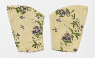 Sleeve of a dress of printed silk fabric, ivory with loosely drawn flowers in purples and greens.