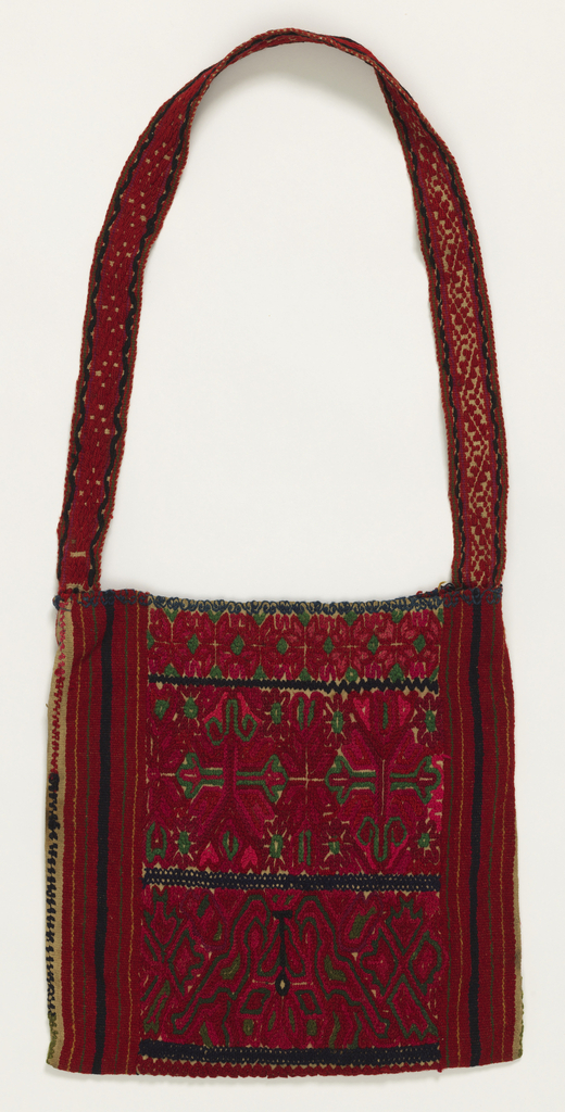 Large shoulder bag with allover embroidery showing confronted birds in red, green and dark blue set off by stylized geometric floral forms.