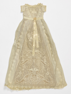 Infant's dress with lace-trimmed square neckline, short sleeves, and pink ribbon sash. Bodice and skirt front heavily embroidered in whitework with insertions.