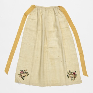 Off-white linen apron embroidered in two lower corners with a sprig of flowers. Yellow silk ribbon ties.