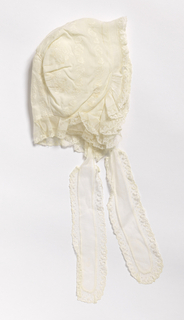 Baby's bonnet with whitework embroidery and lace-trimmed ruffled edge, long lace-trimmed ties.