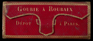 Red, straight-grained Morocco leather portfolio with gilt stamped edges and lettering; green Morocco leather lining; accordion-pleated structure containing 14 panels with 10 samples on each panel and  a top panel of red straight-grained Morocco leather; 16 panels of 10 samples each on other side. Samples are plain and twill weave wool, wool and cotton twills, cotton cloths and twills; some sized and printed with fine check print.