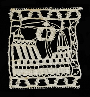 A single square of lace containing a boat with sails.