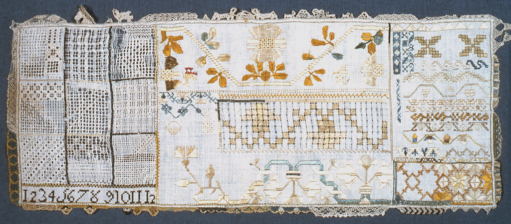 Numerals and assorted designs. The needle lace edging has several patterns including animals.