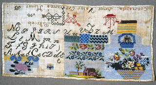 """Baskets of flowers, a landscape with a barn and fence, and bands of geometrical and floral patterns are worked in small glass beads.  Alphabets, ships, hearts and the words """"Constancia"""" """"Amor Valor"""" """"Esperanza"""" and """"Honor"""" are in silk cross stitch."""