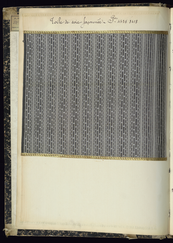 """Printed text on spine: """"1904-1905-06 TOILE SOIE"""" Printed text on front cover: """"FABRIQUE DE REGISTRES TOILE SOIE 1904-1905-1906 C&P P.G.V.F.&C.""""  One tab page, with handwritten text: """"Toile guipure."""" Affixed label on inside front cover text: """" P.G.V.F. & Cie No. 6117 Rappeler ce numéro pour avoir un registersemblable"""".    Each sample has handwritten text above it designating style and number.  Samples are affixed to the page with adhered gold paper strips, embossed with Greek key pattern."""