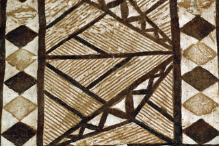 Large panel of tapa cloth. Thick white fabric made from beaten bark, painted in rust and brown in design of three rows of rectangles enclosing striated angular forms. Rows are divided by stripes of diamond pattern.