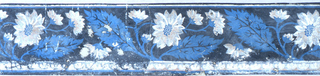 Horizontal rectangle. Border paper with two and one-half repeats of a floral spray. Plain bands of color along upper edge, and plain and figured bands along lower edge. Flowers printed in white with blue centers, and blue leaves, on black ground.