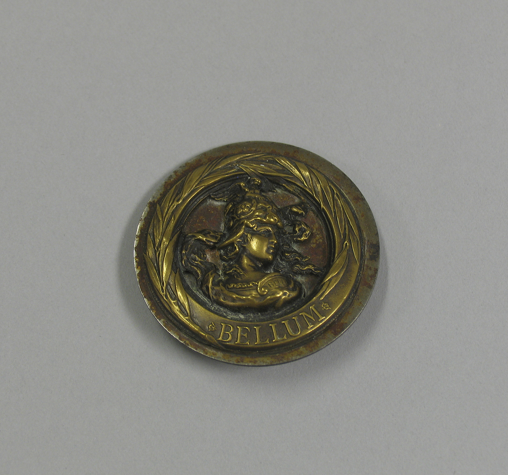 "Circular button with bust of woman (?) in helmet and armor; ""Belli"" on right shoulder. ""BELLUM"" under figure, within band around rim.  On card 43"