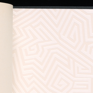 Sample book with black binding, featuring Zeitwande book set into cover.