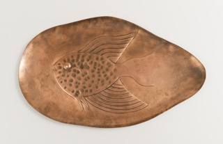 Biomorphic platter with flowing fish motif
