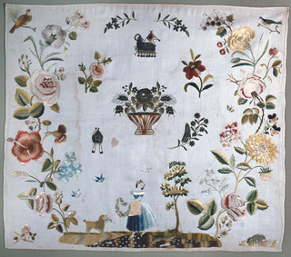 Flowers arranged in a large wreath.  At the bottom a girl with a garland and a poodle carrying a basket.  Metal motifs in the center. Large flowers show the influence of Chinese embroidery in Mexico.