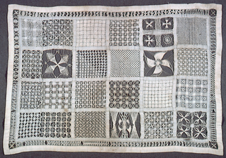 Twenty-four squares of white work pattern.