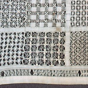 Twenty-four squares of white work pattern.
