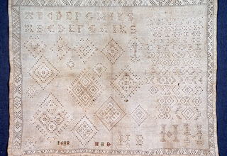 Letters and detached geometric motifs. Withdrawn element work with needle-made fillings using linen.