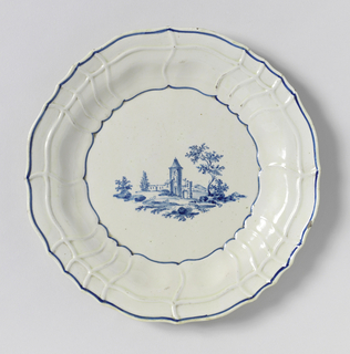 Scalloped marly, with twisted rays in relief. Decorated in underglaze cobalt with landscape vignette.