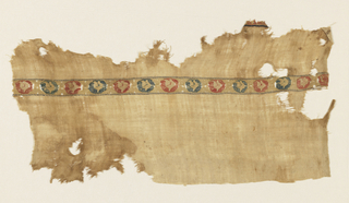 Tiraz fragment of natural-colored linen with a two-centimeter wide band of multicolored silk tapestry medallions with bird-like forms. Fragment of selvedge on one side. Possibly from the Fatamid period.