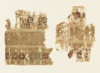 Tiraz fragment of natural linen with three tapestry bands. Two outer bands have a repeat of medallions containing alternately a bird and a rabbit; above and below is Islamic inscription. The central band has a repeating ogee shape with scrolls containing two confronted birds.