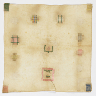 "Ten squares of darning pattern, four patched corners, insert patch in center with crowned monogram and ""gottmit uns"" in a square."