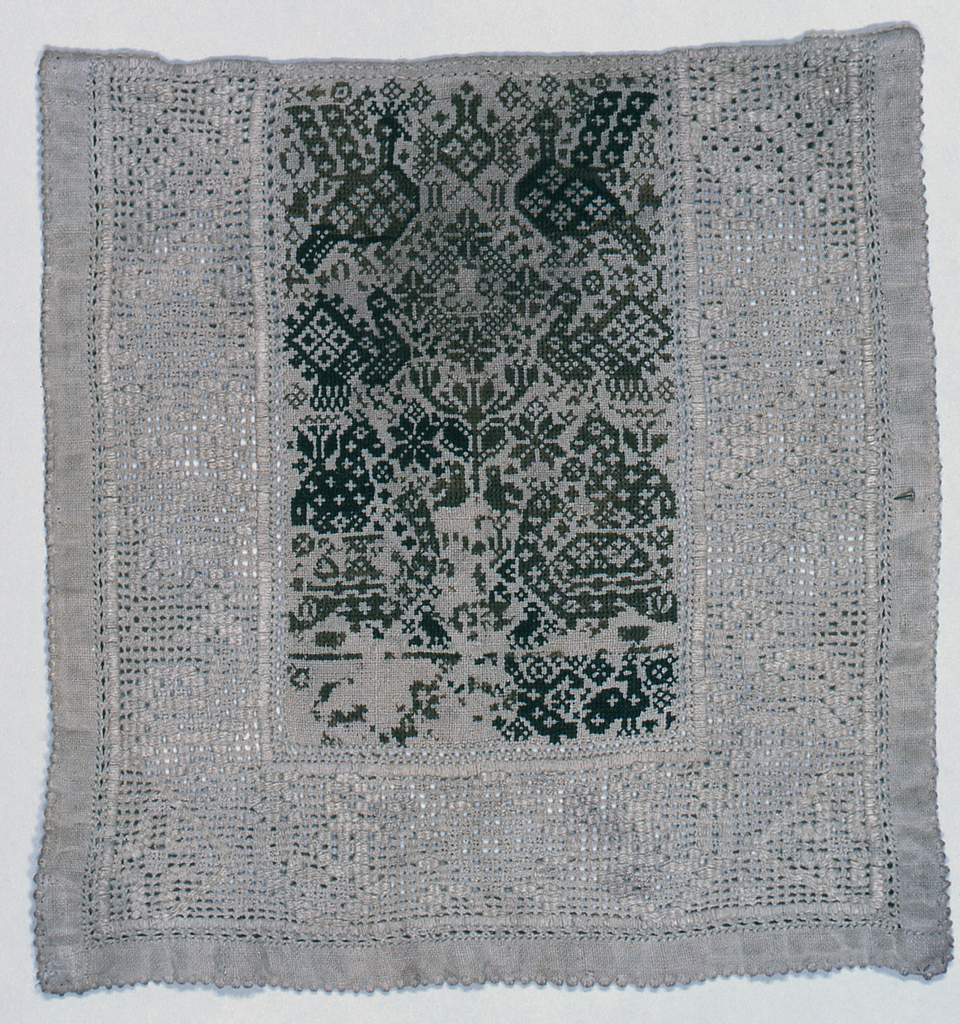 """Panel showing birds, animals, initials """"PS"""" and date, """"1704"""" worked in cross stitch; surrounded on three sides by a band of drawnwork with pattern of birds and animals in darning. Edge worked in clustered overcasting."""