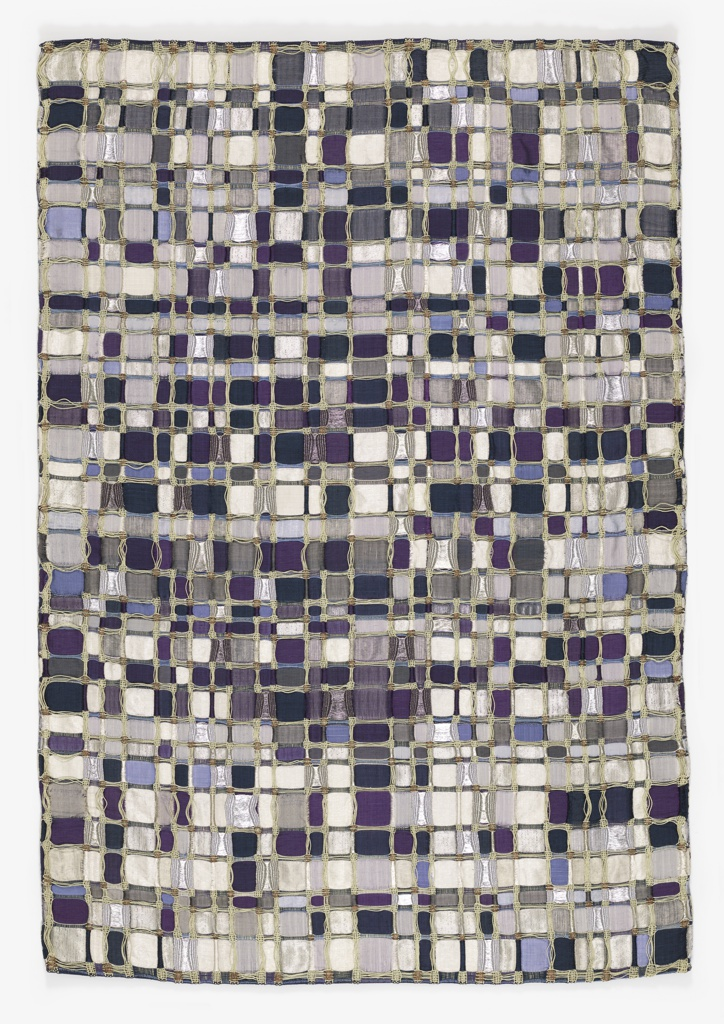 Field of 972 mosaic squares in different shades of blue and metallic with natural color palm fiber complementing the indigo and metallic and partially forming the frame of the mosaic.