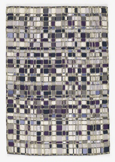 Field of 972 mosaic squares in different shades of blue and metallic with  natural color palm fiber complementing the indigo and metalllic and partially forming the frame of the mosaic.