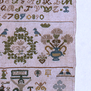 "Geometric and floral cross borders. Alphabets and numerals along with a Crucifixion, a woman, a peacock and other varying designs. Initialed ""C. D. H."""