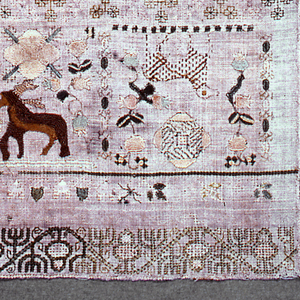 Cross borders showing floral ornament, boxers and animals.  Boxer's head is unfinished.